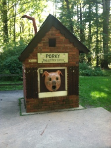 Porky the Litter Eater at Cabin John Park, a giant disembodied pig head mounted on a little brick building.