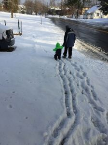 Sprout and I walking around the yard on a snowy day.