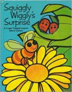 Cover of Squiggly Wiggly;s Surprise, with a bee looking at two worms