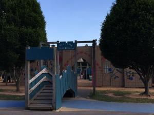 A mock bridge over a moat and castle structure at the South Germantown Adventure Playground