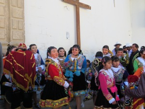 Photo of dancers in full costume and masks waiting to parade as part of the Fiesta de la Virgen del Carmen de Paurcartambo