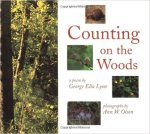 Cover of Counting on the Woods, with photographs of the woods and the title