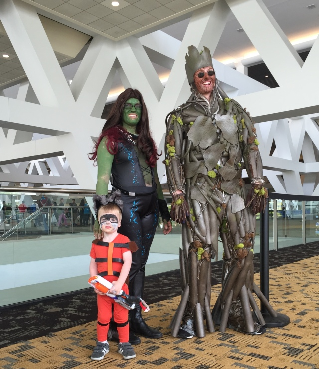 Photo of my family dressed as Groot (my husband), Gamora (me), and Rocket (my two-year-old son)