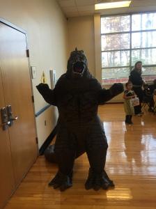 A person in a Godzilla costume