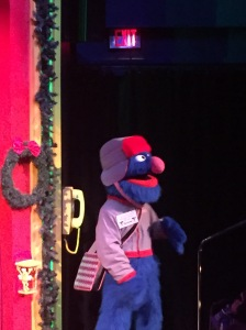 Grover as Santa's postman in Elmo the Musical at Sesame Place