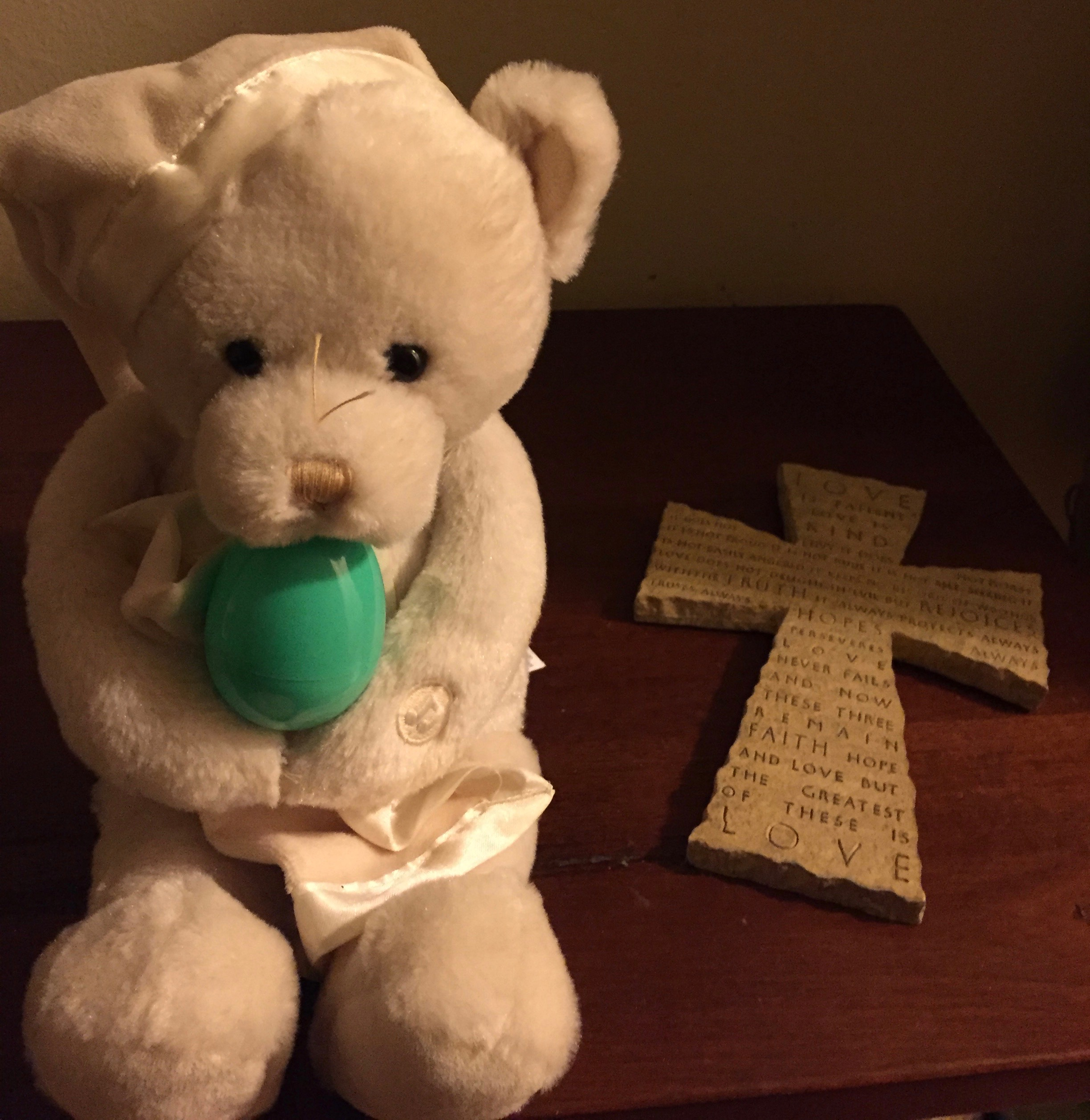 Cross and teddy bear with Easter Egg