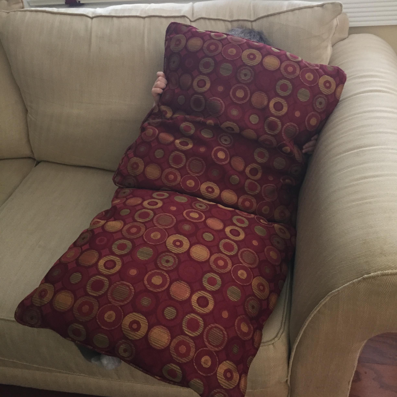 Hiding behind pillows