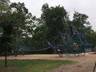 "Photo: Two ""spiderweb"" pieces of playground equipment connected with a bridge at Wheaton Regional Park's adventure playground."