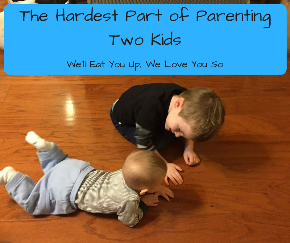 "Text: ""The Hardest Part of Parenting Two Kids; We'll Eat You Up, We Love You So"" Picture: Baby on floor and older brother leaning over him"