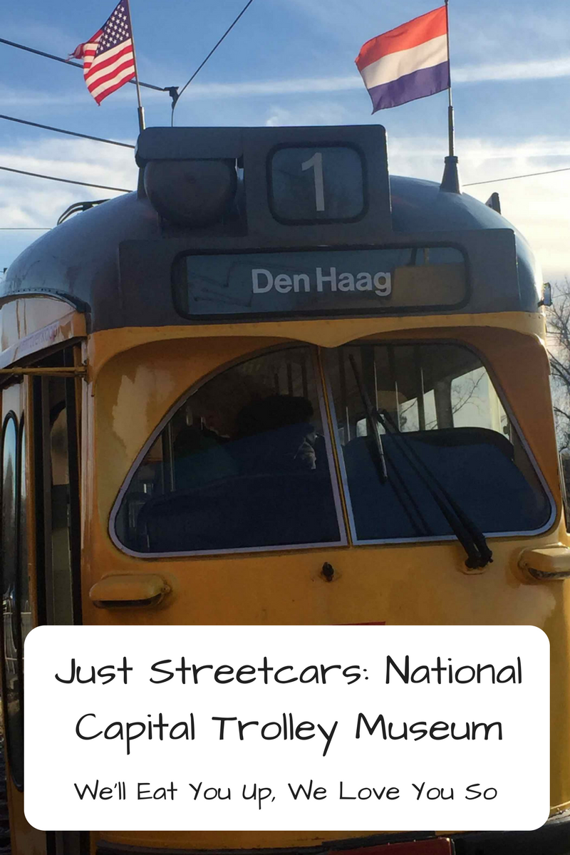 Photo: A Dutch electric streetcar with a Dutch and American flag on top; Text: