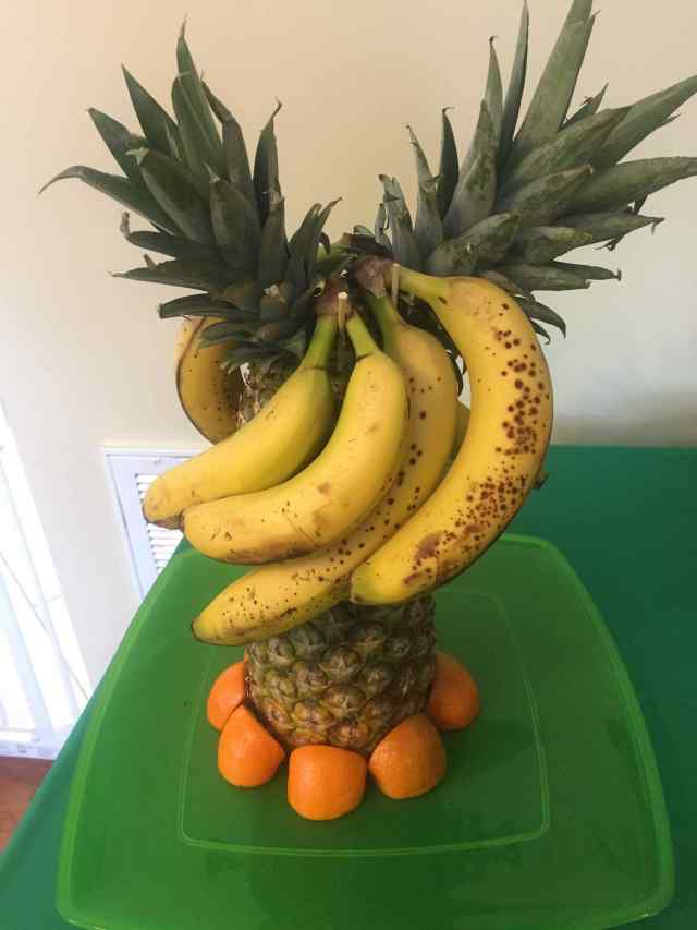 Photo: A fake banana tree made out of pineapples on a green tray