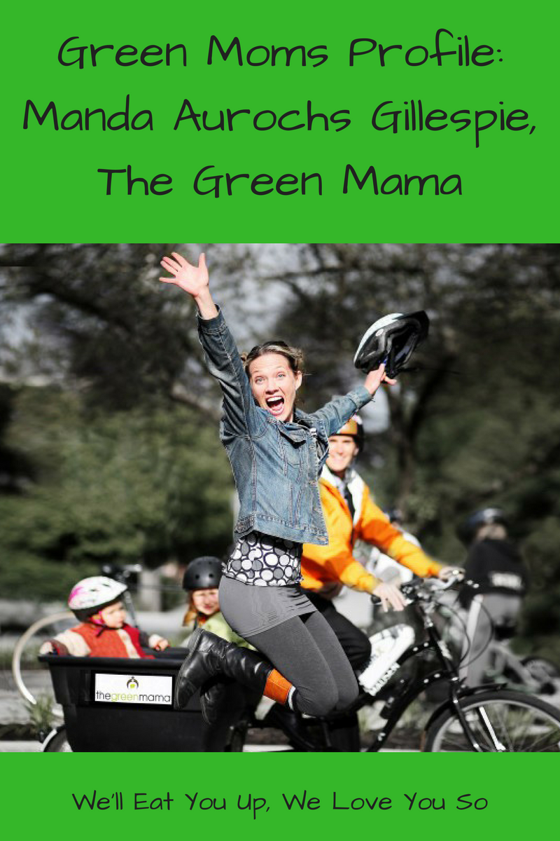 "Text: ""Green Moms Profile: Manda Aurochs Gillespie, The Green Mama / We'll Eat You Up, We Love You So"" Photo: A woman jumping with a bike helmet in her hand in front of a box bike ridden by a man with two kids in the back"