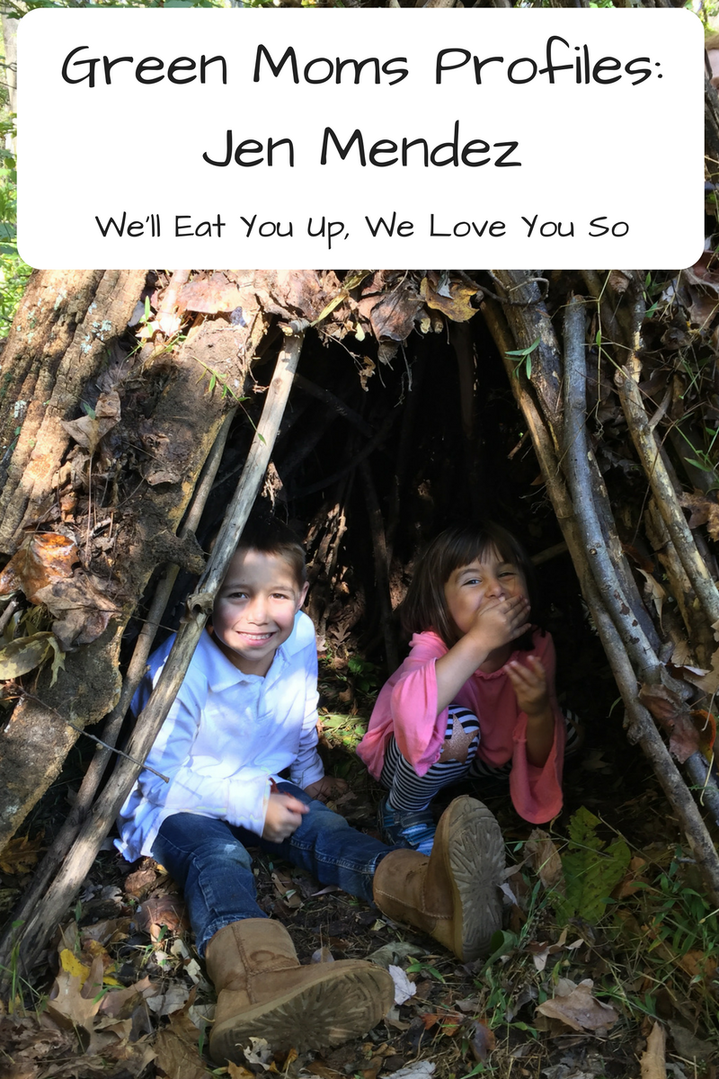 "Text: ""Green Moms Profiles: Jen Mendez / We'll Eat You Up, We Love You So"" Photo: Photo of a boy and a girl underneath a shelter made of sticks"