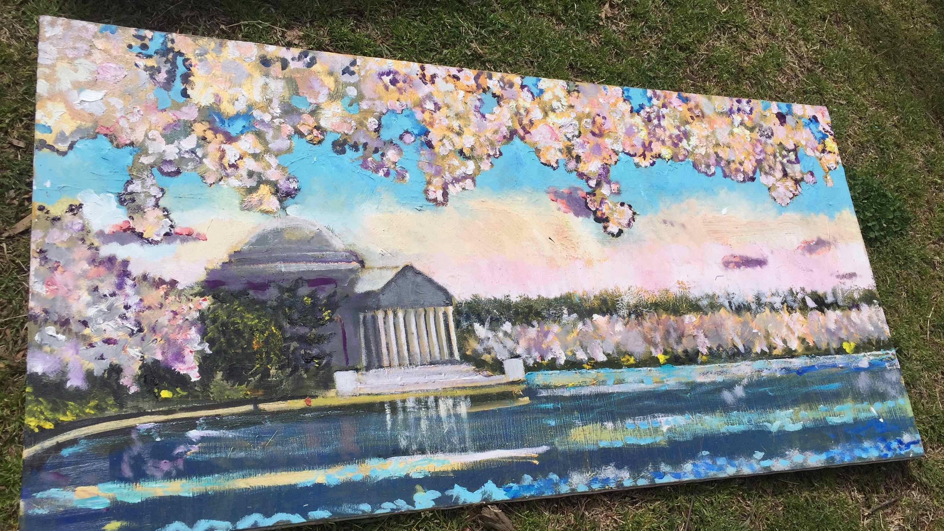 Photograph: Painting of the Jefferson Memorial framed in the branches of a cherry blossom tree