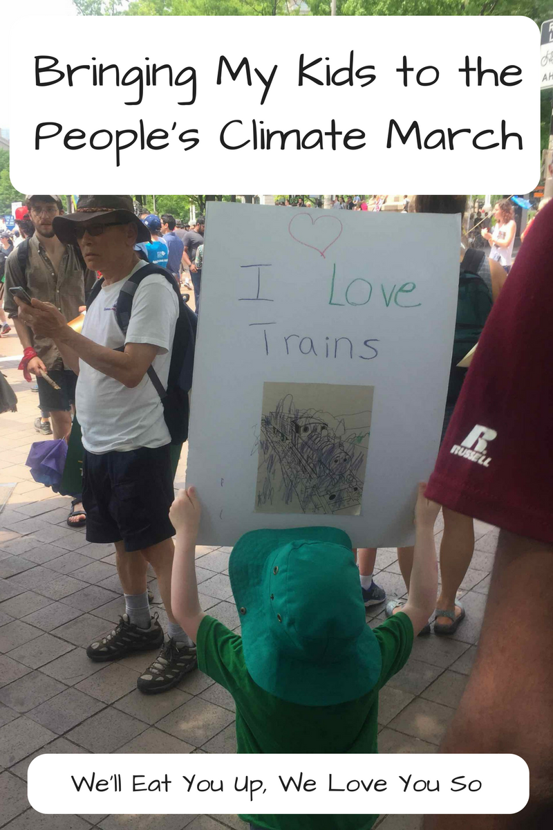 "Text: ""Bringing My Kids to the People's Climate March / We'll Eat You Up, We Love You So"" Photo: Young boy in a teal hat holding up a sign that says"